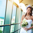 Portrait of happy bride with a wedding bouquet — Stock Photo
