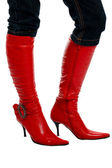 Woman's legs in red boots — Stock Photo