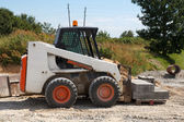 Small excavator Bobcat — Stock Photo