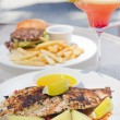 Grilled seabass with potato slices — Stock Photo
