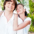 Happy couple embracing on a tropical beach — Stock Photo
