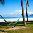 Panoramic view ow tropical beach with umbrelland two beds — Stock Photo #11047617