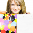 Happy smiling woman holding shopping bags — Stock Photo