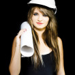 Isolated young female structural engineer — Stock Photo