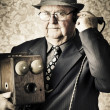 Vintage business man using retro telephone — Foto Stock