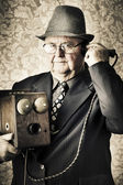 Vintage business man using retro telephone — Stock Photo