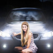 Girl in front of a luxury car - Stock Photo
