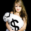 Happy woman with a bag of American dollar bills - Stock Photo
