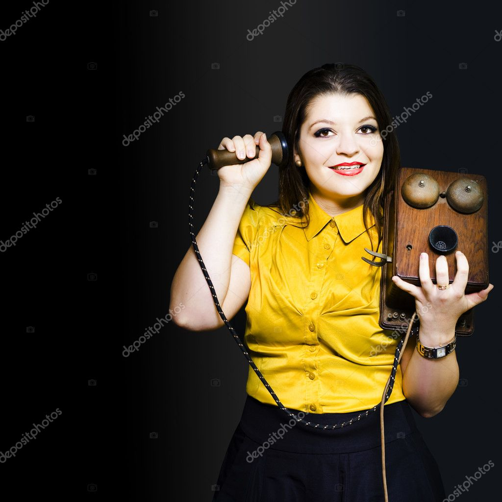 Young woman totally immersed and enthralled by the latest news and snippets of scandal gossiping on a vintage telephone with bells — Stock Photo #10995148