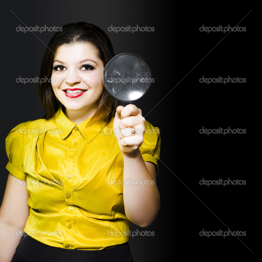 Woman with large magnifying glass doing data recovery searching and locating corrupted files and information for retrieval and recovery on a computer harddrive, conceptual — Stock Photo #10995150