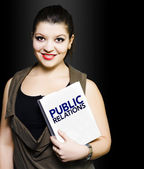 Smiling woman with public relations folder — Stock Photo
