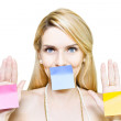 Beautiful woman holding blank message sticky paper - Stock Photo