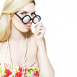 Stereotypical nerd in glasses - Stock Photo