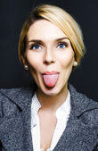 Cheeky business woman sticking out tongue — Stock Photo
