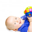 Gurgling Happy Baby With Toy — Stock Photo