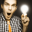 Male Business Person With Light Bulb In Hand — Stock Photo