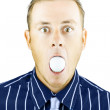 Dumbfounded man silenced by a golf ball — Stock Photo