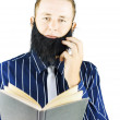 Smart man reading book of knowledge - Stock Photo