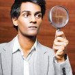 Foto Stock: Business audit under magnifying glass