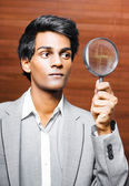 Business audit under a magnifying glass — Stok fotoğraf