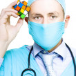 Healthcare Practitioner With A Medical Puzzle - Stock Photo