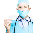 Doctor with business card — Stockfoto