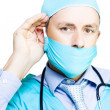 Concerned Doctor Listening To Patient Concerns - Stock Photo