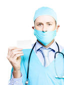 Doctor with business card — Stock Photo