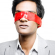 Blinded by red tape or Held to ransom - Stock Photo