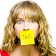 Woman with tax note over mouth - Stock Photo