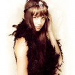 Stock Photo: Retro showgirl in feather boa