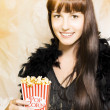 Stock Photo: Buttered popcorn at showtime