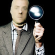 Criminal with magnifying glass — Stock Photo