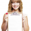 Smiling woman with blank clipboard — Stock Photo #11933710
