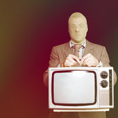 Retro burglar stealing television on black — Zdjęcie stockowe