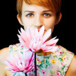 Lovely woman in floral dress holding flowers — Foto de Stock