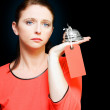 Woman holding service bell with tipping price tag — Stock Photo