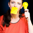 Business woman with idea holding yellow light bulb — Foto de Stock