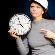 Royalty-Free Stock Photo: Female Construction Builder Pointing At Clock