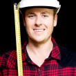 Happy builder with a tape measure — Stock Photo