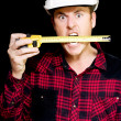 Crazy builder biting his tape measure — Stock Photo