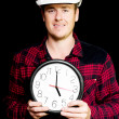 Builder with clock showing home time — Stock Photo #11989184