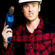 Furious out of control construction site worker — Stock Photo