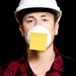Workman with a sticky note reminder — Stock Photo #11989194