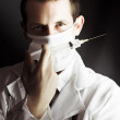 Stock Photo: Medical surgeon with prescribed medicine injection