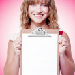 Stock Photo: happy woman showing a blank copyspace clipboard