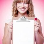 Happy woman showing a blank copyspace clipboard — Stock Photo