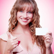 Business woman handing over a blank business card - Stock Photo