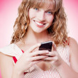 Stock Photo: Beautiful womtexting on her cellphone