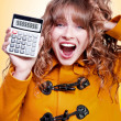 Excited winter womholding savings calculator — Stock Photo #12160399